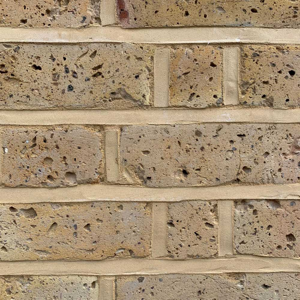 Pebbledash Removed and brick repointed