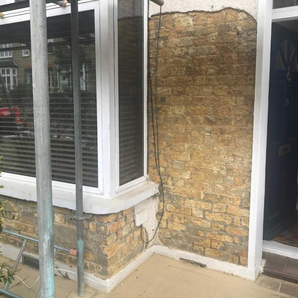 Removing pebbledash to discover the original bricks of the property
